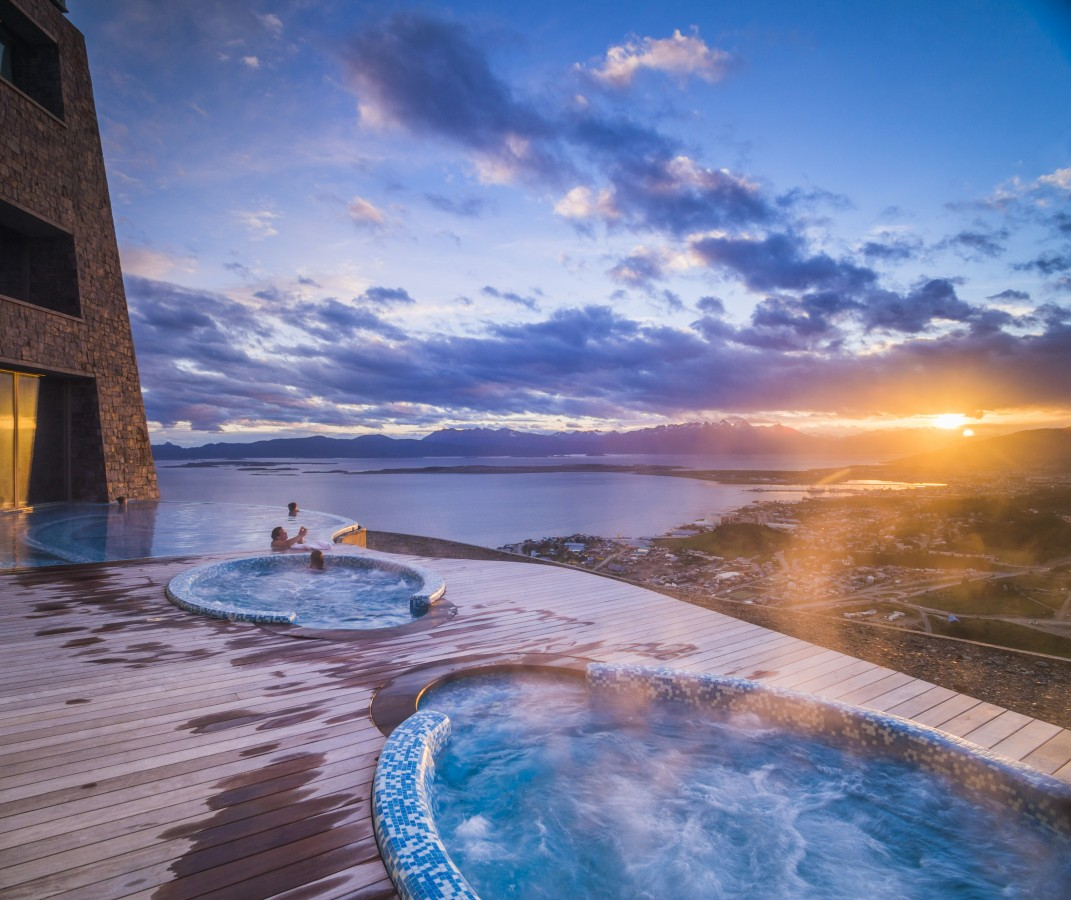 Outdoor swimming pool and jacuzzi at sunset, Hotel Arakur Ushuaia Resort and Spa, Ushuaia, Tierra del Fuego, Patagonia, Argentina