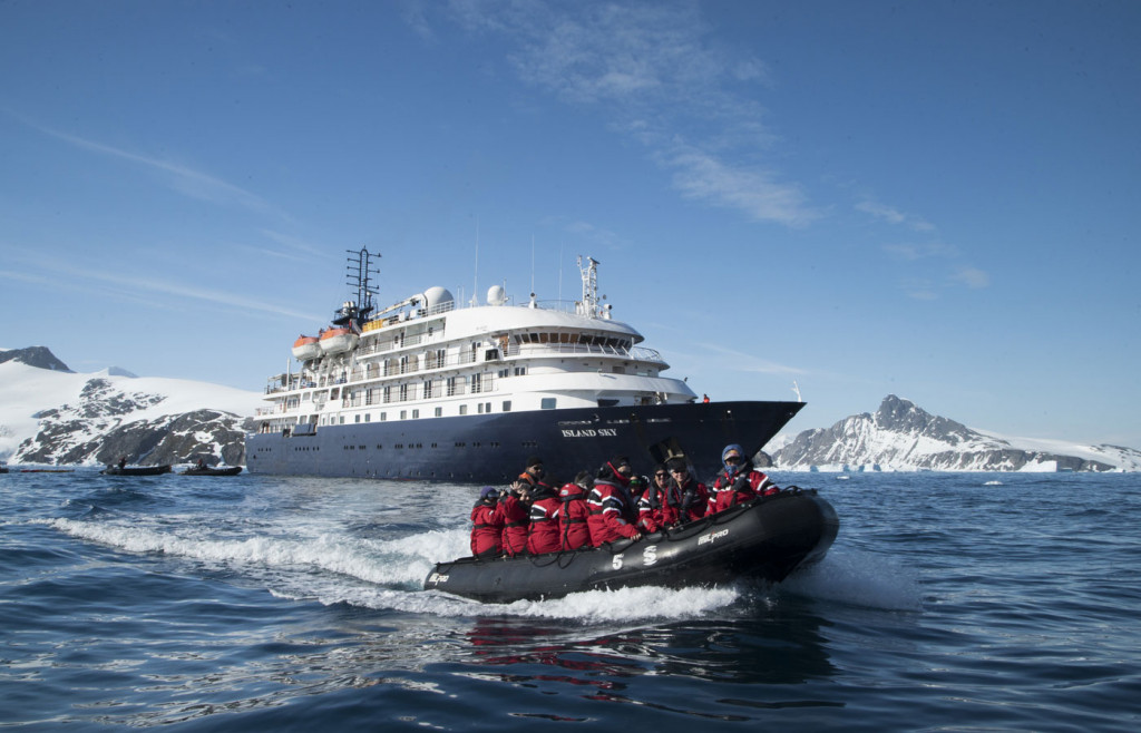 The exterior of the luxury cruise ship The Island Sky with an expedition zodiac pictured