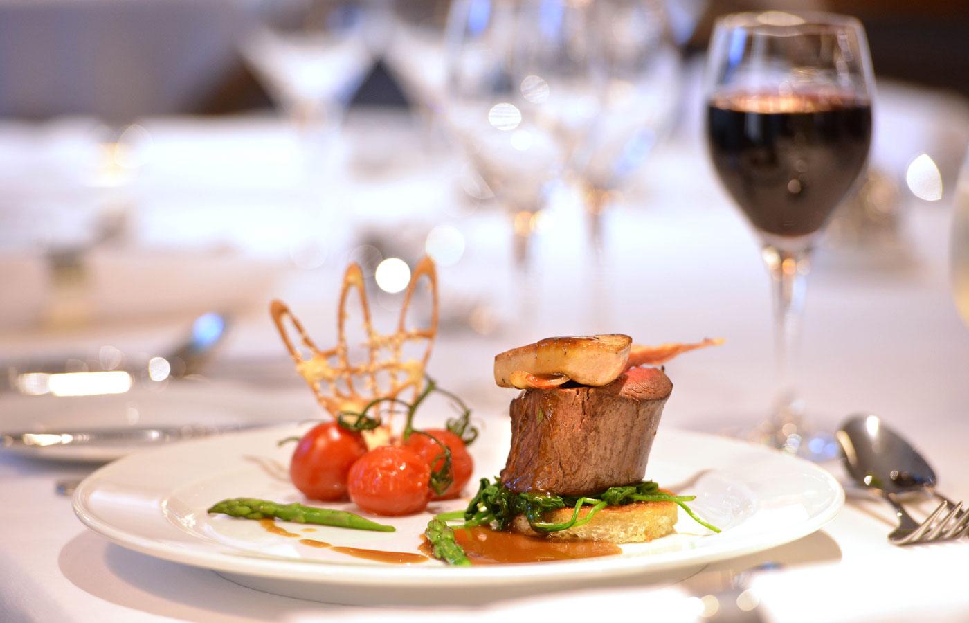 Refined gourmet cuisine aboard the Island Sky luxury cruise ship