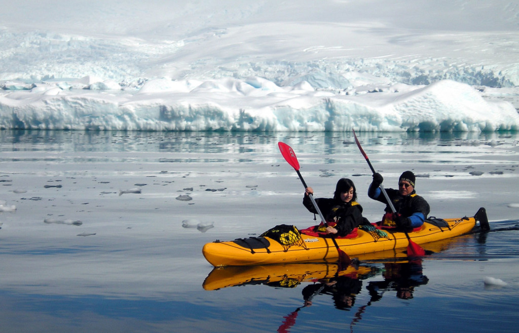Intrepid explorers can enjoy kayaking amongst the icebergs aboard an Island Sky cruise itinerary
