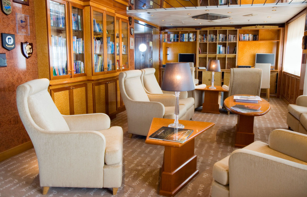 The well-stocked library aboard The Island Sky luxury cruise ship in Antarctica