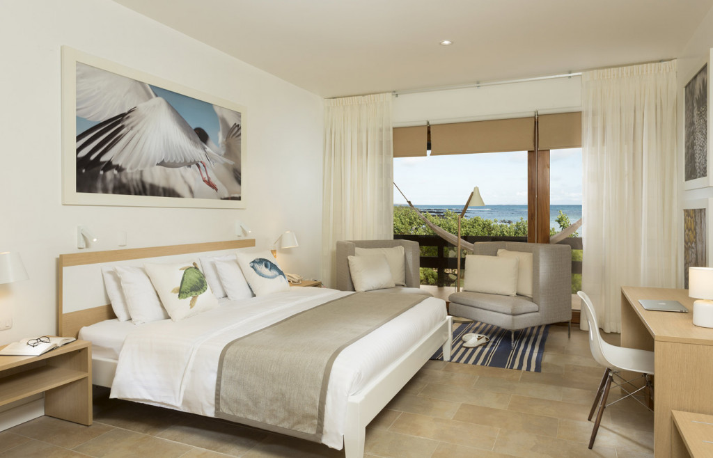 A room at Finch Bay hotel - light neutral palette and sea views
