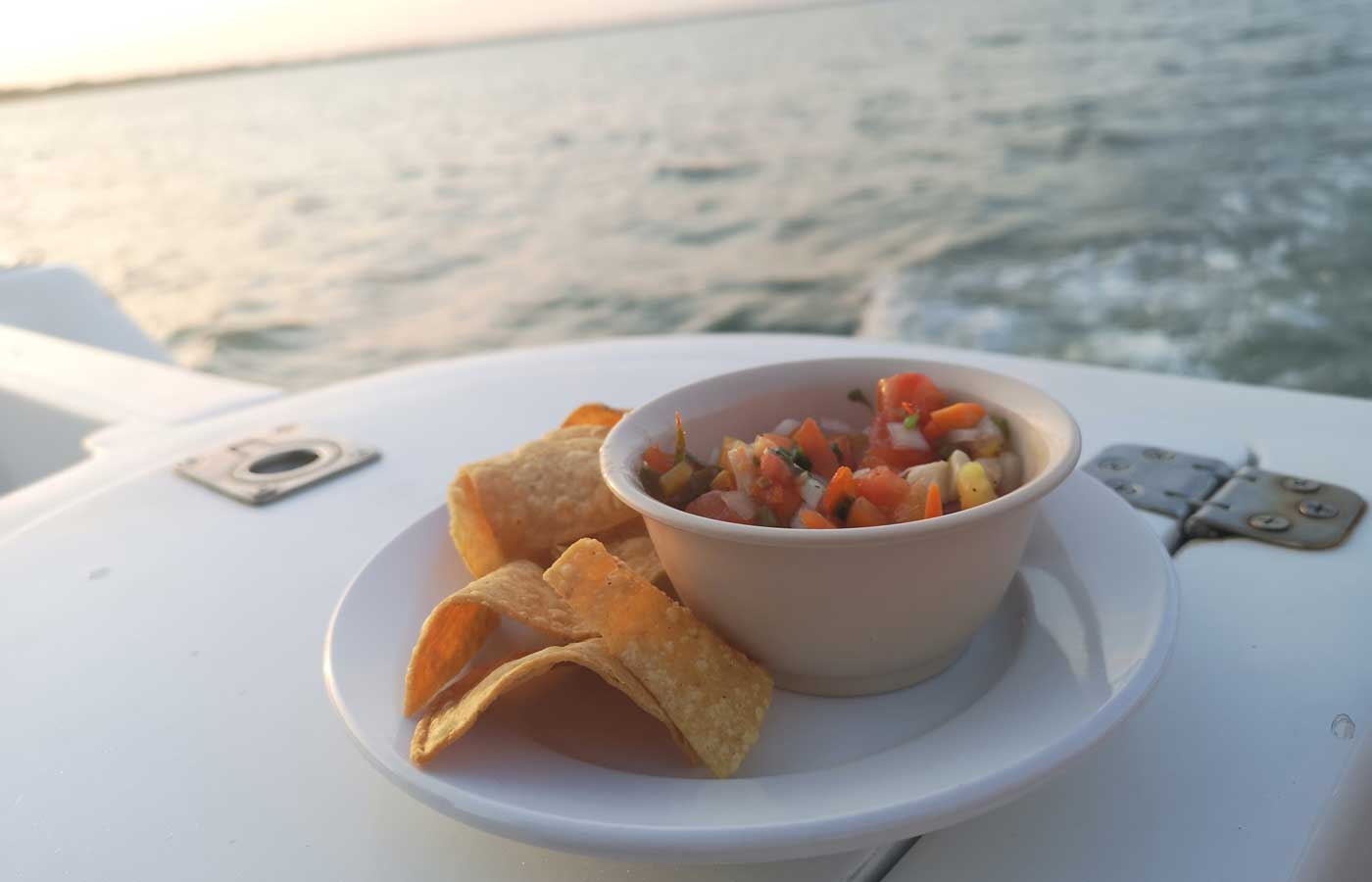 Snacks and drinks aboard a luxury sunset cruise in southern Belize